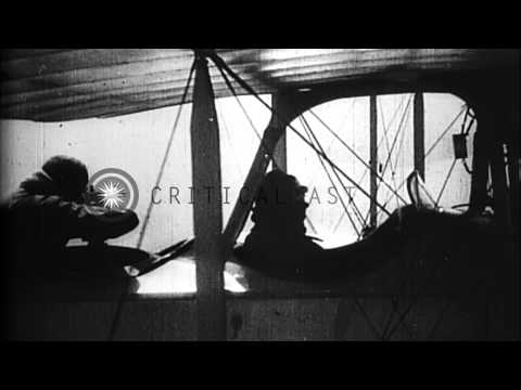 German warplane dropping bombs and engaging Allied airplane during World War I HD Stock Footage