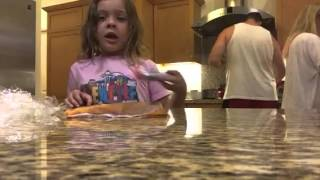 4 year old girl explains how to make Carmel apples for Halloween