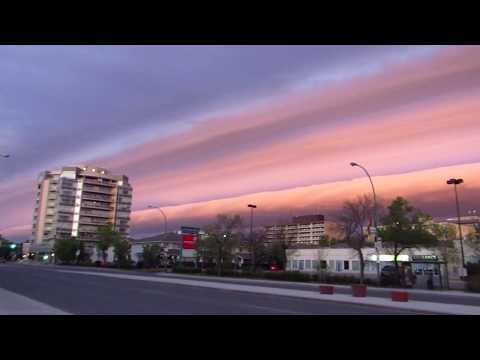 Early Morning Storm Front with Pink Shelf Cloud - June 9, 2017