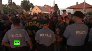 Out of the frying pan, into the fire: Migrants escape Croatian police on border, met by Slovenian