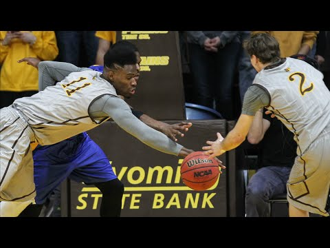 Wyoming's Cooke Jr. Shows His Height With This Massive Block | CampusInsiders