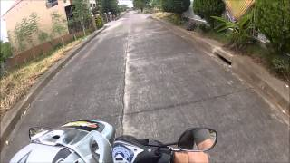 Young girl drives Motorcycle