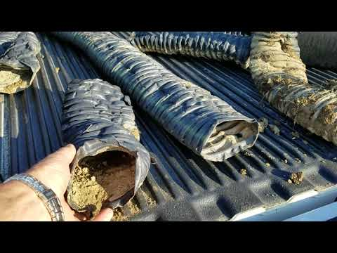 Residential Stone French Drains vs Drain Tiling in a Farm Field