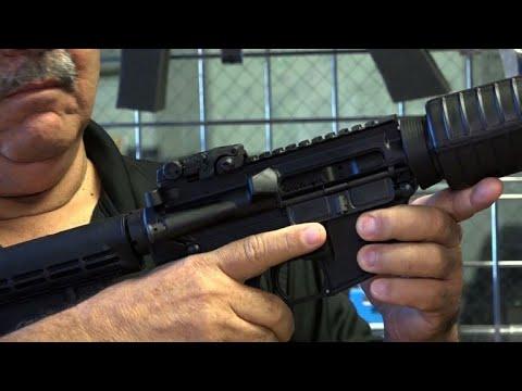Florida gunshop owner displays a semi-automatic rifle