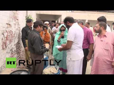 Pakistan: Selling porkies?! 'Pig fat' suspected of use in ...