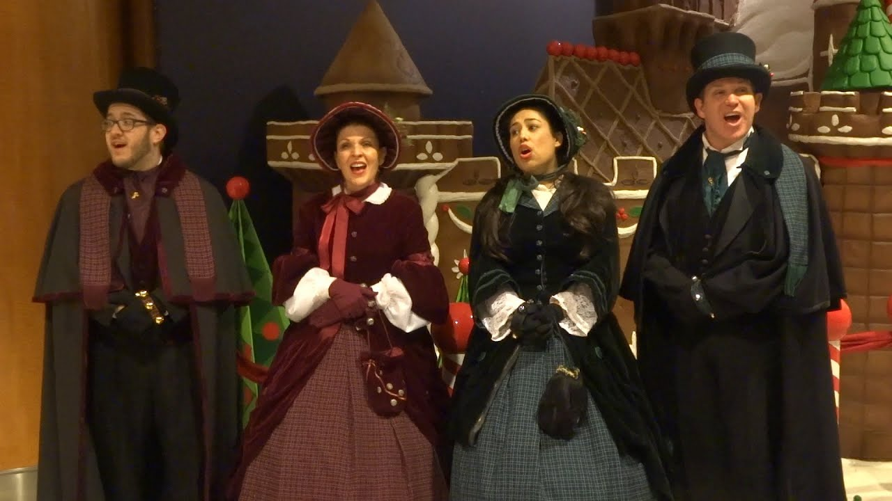 let it go from frozen performed by christmas carolers at disneyland hotel - Christmas Carollers