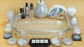 Holo Slime Mixing makeup and glitter into Clear Slime