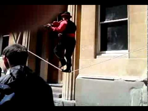 Amazing man on tight rope playing violin