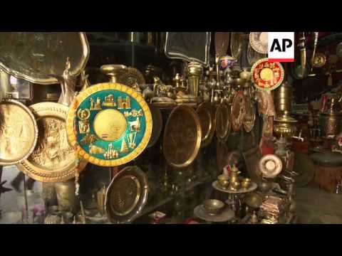 Baghdad coppersmiths forced to hang up tools