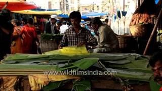 Man diligently cuts banana leaves for use as plates in Coimbatore thumbnail