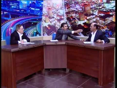 Jordanian member of parliament point a gun at his opponent on the air