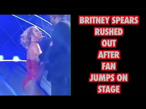 BRITNEY SPEARS RUSHED OUT AFTER FAN JUMPS ON STAGE