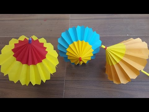 How to make a paper umbrella that open and closes- Step by step process.