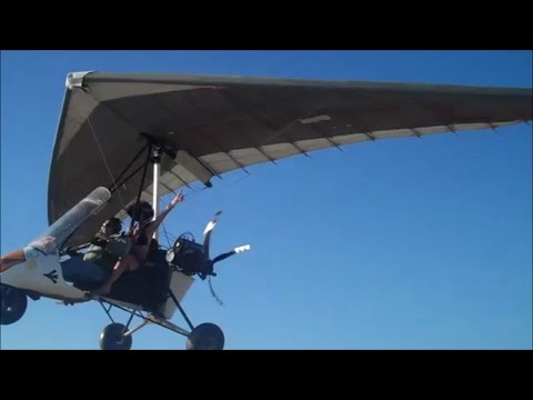 Melissa rides high above the ocean in a motorized hang glider!
