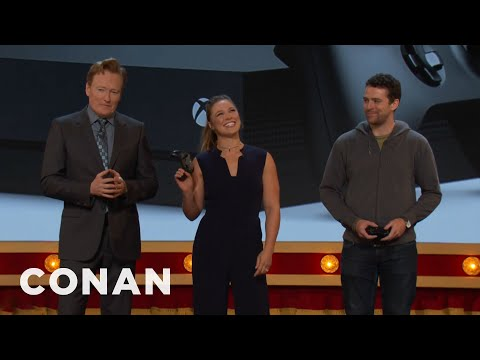 Ronda Rousey Demonstrates The True Power Of The Xbox One X Console   CONAN on TBS