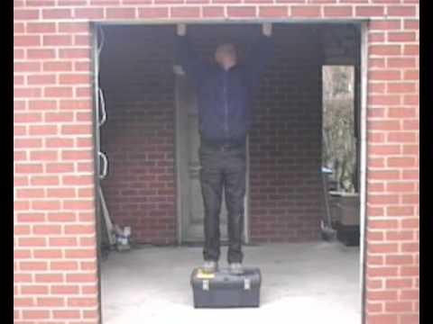 Garage Door Installation   Installation Of Door Guides And Barrel