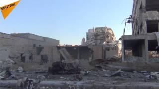 """بالفيديو والصور... حي """"بني زيد"""" يعود إلى الحياة مجدداً بعد الجهود السورية الروسية"""