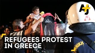 Riot Police Clash With Refugees On Greek Island Of Lesbos