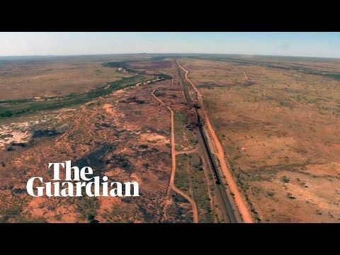 BHP train derailment: footage shows two-kilometre train crash in outback Australia