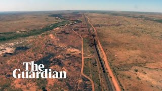 BHP train derailment: footage shows two-kilometre train crash in outback Australia