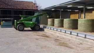 AgriCompact Technologies GmbH:  unloading alfalfa hay bales  from our Hay Dryer Thumbnail