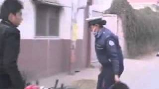 Nepal Police officer hit bike rider on a schedule licence check