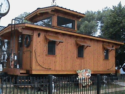 Caboose Railcar With House In Garden