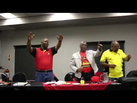 Acting NUM President singing and dancing with delegates