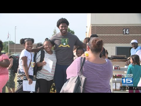 Rod Smith hands out backpacks at Prince Chapman Academy on 7/12/18