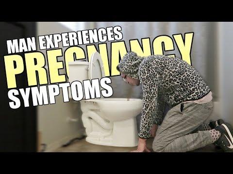 man-experiencing-pregnancy-symptoms..