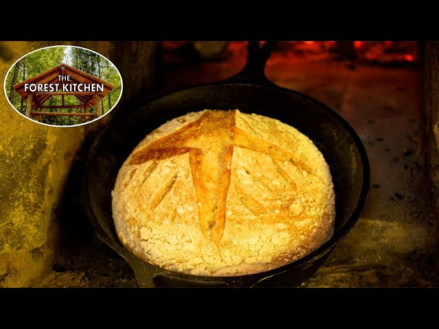 Baking Homemade Sourdough Bread in a Clay Oven in the Forest