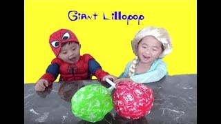 Spiderman and Elsa Open Giant Lollipop Surprises