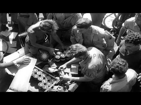 US Army 77th Infantry Division soldiers relax on a ship in the Pacific Theater ...HD Stock Footage