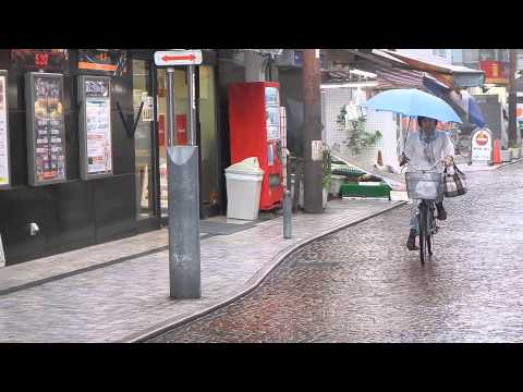 The Art of Riding a Bike in Japan in the Rain