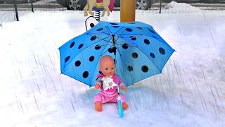 Masha and her Doll Playing In the Rain