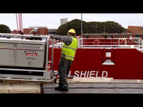 Australian navy vessel ADV Ocean Shield prepares for departure in search for MH370