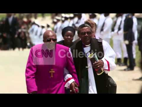 MANDELA:ARCHBISHOP TUTU WALKING TO GRAVESITE