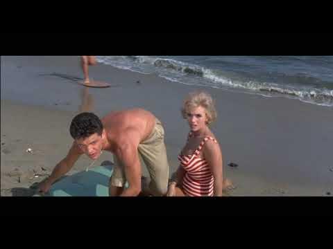 Busty beach blonde