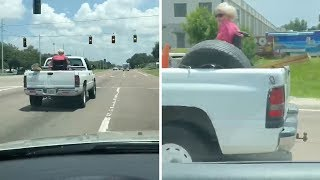 Grandma Rides In Back Of Pick-up Truck On Wheelchair