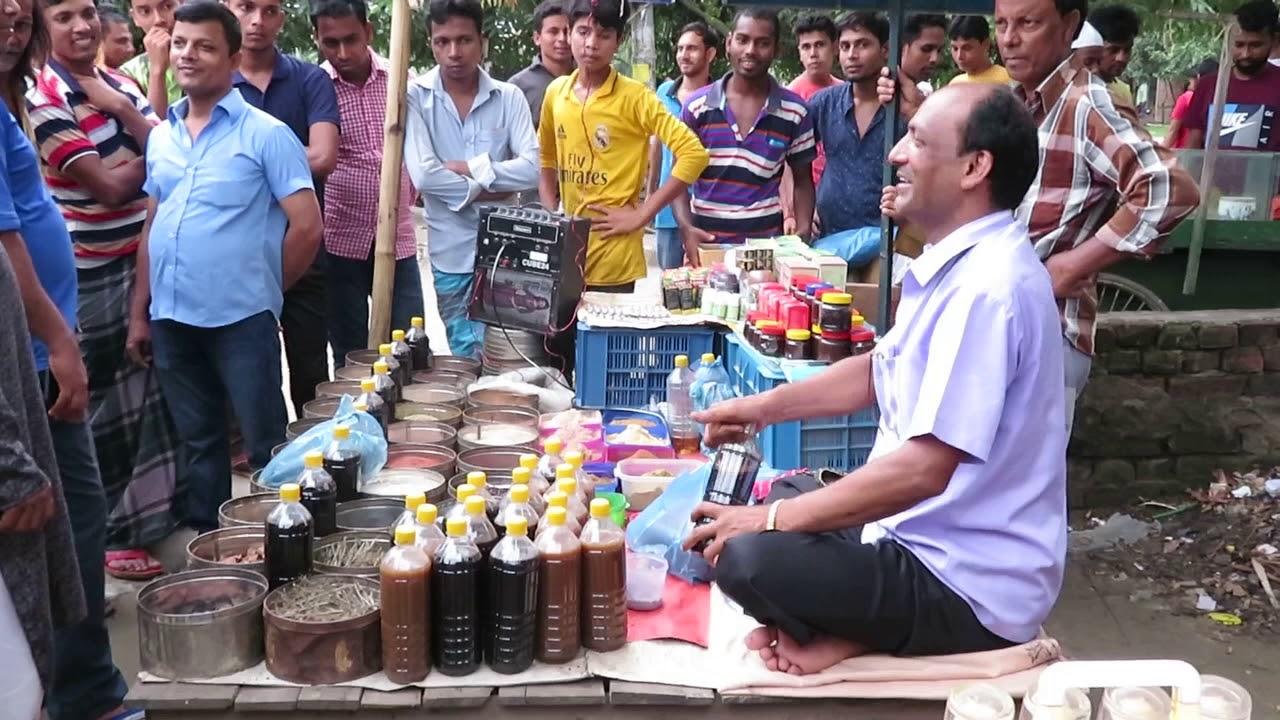 Herbal medicine sheller is selling her medicine. ভেষজ ঔষধ বিক্রেতা তার ঔষধ বিক্রি করছে। #Herbalmedicine
