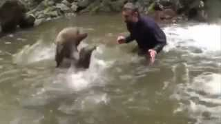 A Brave Man Hugs Young Bear in the River!