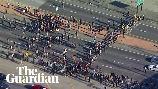 George Floyd: aerial footage shows protesters block LA highway