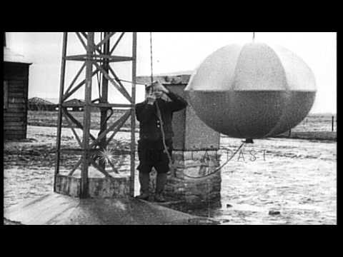 French signalman raises signal ball on a semaphore tower in France during World W...HD Stock Footage