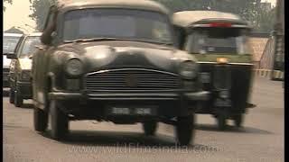Maruti 800 and Ambassador cars on Delhi roads - archival