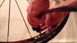 How to pump a road bike tire
