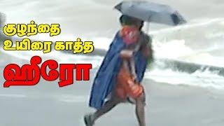 Viral video   Man saves child from Kerala Flood