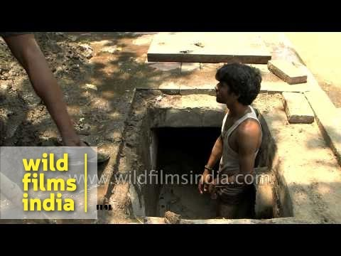 This is how we do it: cleaning a sewage drain in India