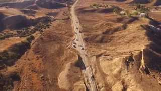 Moving Road, landslides buckles, lifting highway 15 feet in the AIR. Aerial video Vasquez Canyon