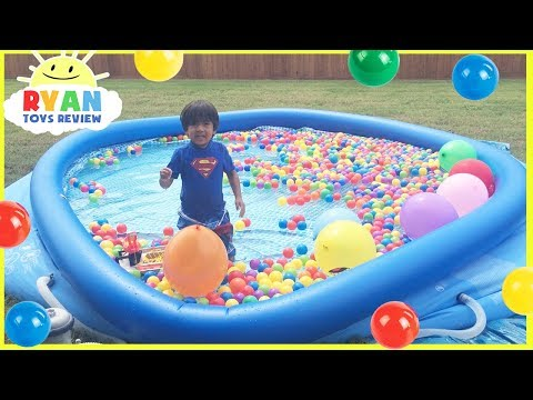 BALLOON POP CHALLENGE in Giant Inflatable Pool with Giant Ball Pits