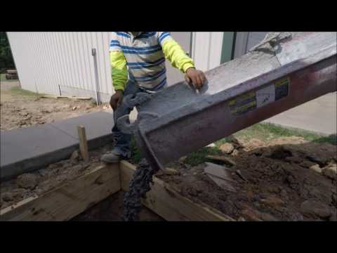 HOW TO SET CEMENT FOUNDATION PIERS. BELL BOTTOM PIERS.PART 1 OF 3